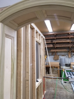 A better picture of the top of the paneled doorway.