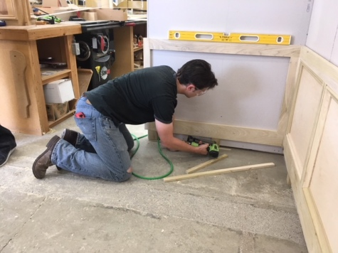 Me installing some wainscotting.