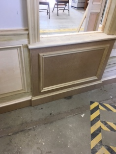 Wainscoting under a window.